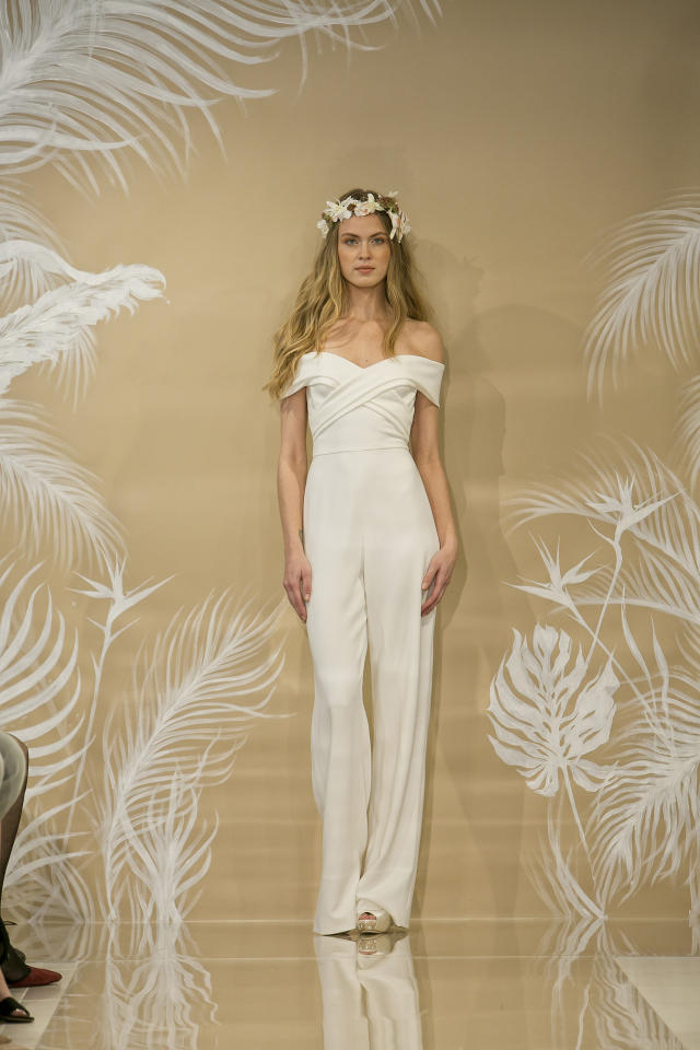 <p>For all future tropical-destination weddings, a simple off-the-shoulder ivory jumpsuit for the big day.</p><p><i>(Photo: Courtesy of Theia)</i></p>