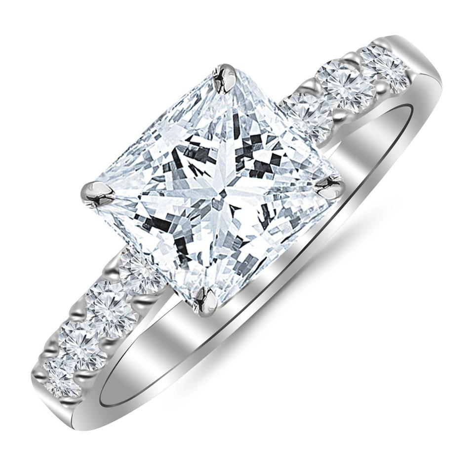"""<h3><a href=""""https://amzn.to/2uUswwo"""" rel=""""nofollow noopener"""" target=""""_blank"""" data-ylk=""""slk:Diamond Wedding Ring"""" class=""""link rapid-noclick-resp"""">Diamond Wedding Ring</a></h3><br><strong>Kristyn</strong><br><br><strong>How She Discovered It:</strong> """"So this is a similar style ring - I can't find my exact ring. But, it was given to me on Christmas eve when I got engaged :) My main stone is 1.6 ctw """"very good"""" quality diamond and I think was around 4k he never told me the exact amount.""""<br><br><strong>Why It's A Hidden Gem:</strong> """"My husband and I both really enjoy deal shopping — it's one of our pastimes haha so he knew I'd have no issues with him getting a great deal on my ring — I just wanted to be married! It's an antique-style setting and really fits my style so I immediately fell in love with it. Once we got it appraised it was valued at a lot more than he paid — like 7k more! It came with an appraisal certificate that was already more than he paid but we took it to a reputable jeweler who went NUTS for it and appraised it even higher. Jewelers especially often ask me if its a family heirloom because they say it's beautifully crafted. I love it so much i choose to wear it on my right hand because I don't want a band taking any attention away from the details on the sides.""""<br><br><strong>Houston Diamond District</strong> Princess Cut 14K White Gold Prong-Set Diamond Ring, $, available at <a href=""""https://amzn.to/2uUswwo"""" rel=""""nofollow noopener"""" target=""""_blank"""" data-ylk=""""slk:Amazon"""" class=""""link rapid-noclick-resp"""">Amazon</a>"""