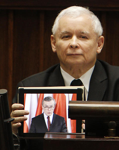 Leader of Poland's nationalist Law and Justice opposition party, Jaroslaw Kaczynski uses his tablet to bypass Parliament rules banning non-lawmakers from taking the floor. Himself a lawmaker authorized to speak from the podium, Kaczynski plays to the lower chamber a pre-recorded speech by Piotr Glinski, his party's shadow cabinet prime minister. Kaczynski took the floor during a debate over his own motion for a vote of no confidence in the incumbent Cabinet of Prime Minister Donald Tusk, in Warsaw, Poland, on Thursday, March 7, 2013. The vote scheduled for Friday is expected to fail for lack of sufficient support. (AP Photo/Czarek Sokolowski)
