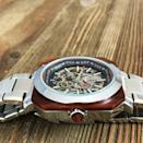"""<p><strong>Benjamin Banneker Watches</strong></p><p>bannekerstore.com</p><p><strong>$425.00</strong></p><p><a href=""""https://www.bannekerstore.com/crossover-silver/"""" rel=""""nofollow noopener"""" target=""""_blank"""" data-ylk=""""slk:Shop Now"""" class=""""link rapid-noclick-resp"""">Shop Now</a></p><p>Each Benjamin Banneker watch incorporates wood in some way. For the Crossover, African Red Sandalwood is layered over a steel-lated case. </p><p>Case size: 44 mm</p>"""