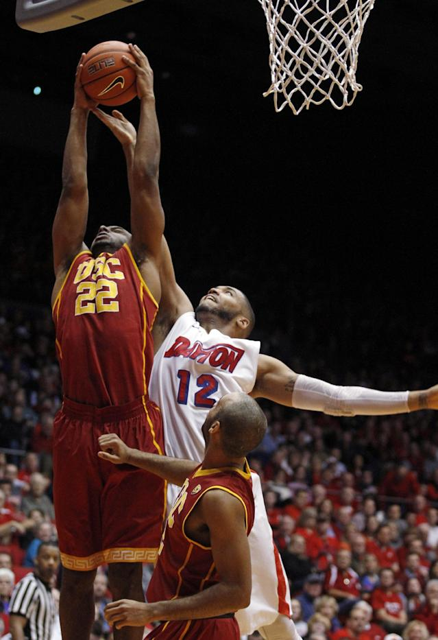 Southern California's Byron Wesley (22) grabs a rebound from Dayton's Jalen Robinson (12) during the first half of an NCAA college basketball game, Sunday, Dec. 22, 2013, in Dayton, Ohio. (AP Photo/Skip Peterson)