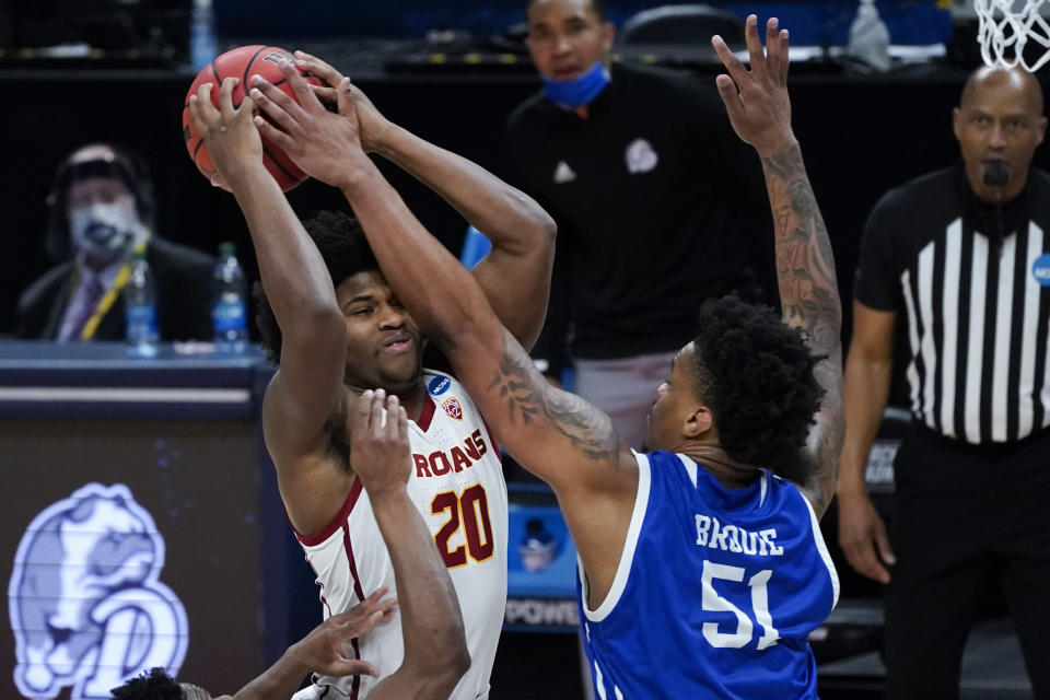 Drake forward Darnell Brodie (51) blocks USC guard Ethan Anderson (20) during the first half of a men's college basketball game in the first round of the NCAA tournament at Bankers Life Fieldhouse in Indianapolis, Saturday, March 20, 2021. (AP Photo/Paul Sancya)