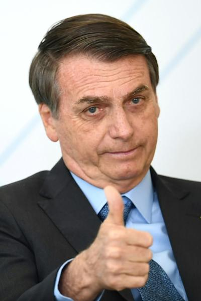 "Brazilian President Jair Bolsonaro attributes the fires to increased drought, and accuses environmental groups and NGOs of whipping up an ""environmental psychosis"" (AFP Photo/EVARISTO SA)"