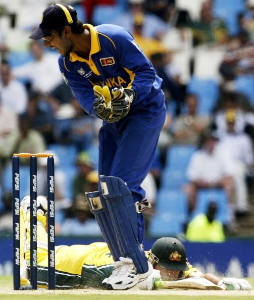 CENTURION- MARCH 7:  Ricky Ponting of Australia slides into his ground as Kumar Sangakkara of Sri Lanka fails to remove the bails on his first attempt during the World Cup Super Six One Day International between Australia and Sri Lanka played at Super Sports Park, Centurion, South Africa, on March 7, 2003. (Photo by Hamish Blair/Getty Images)