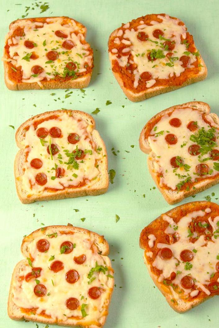 """<p>The easiest way to make pizza.</p><p>Get the recipe from <a href=""""https://www.delish.com/cooking/recipe-ideas/recipes/a57141/pizza-toast-recipe/"""" rel=""""nofollow noopener"""" target=""""_blank"""" data-ylk=""""slk:Delish"""" class=""""link rapid-noclick-resp"""">Delish</a>. </p>"""