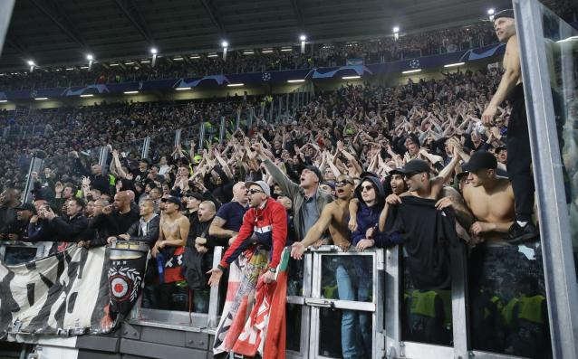 Ajax fans celebrate at the end of the Champions League, quarterfinal, second leg soccer match between Juventus and Ajax, at the Allianz stadium in Turin, Italy, Tuesday, April 16, 2019. Ajax won 2-1 and advances to the semifinal on a 3-2 aggregate. (AP Photo/Luca Bruno)