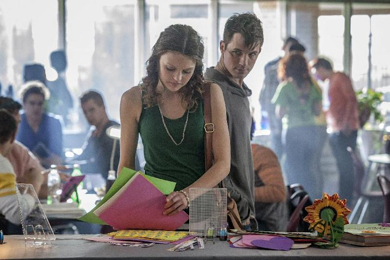 "This publicity image released by The CW shows Aimee Teegarden as Emery, center, and Matt Lanter as Roman in the pilot episode of the new series ""Starcrossed,"" airing this fall on the CW. (AP Photo/The CW, Skip Bolen)"