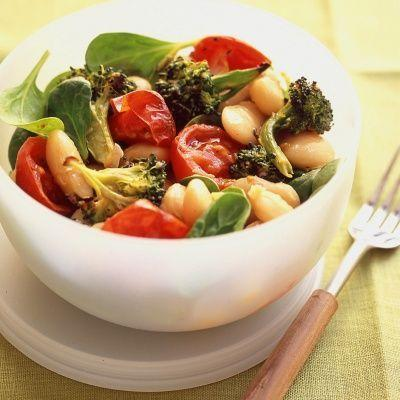 """<p>For a smaller dish, this zesty, vegan white bean salad may be the lighter fare you're looking for. Beans and tomatoes are two """"superfoods"""" that the ADA <a href=""""https://www.diabetes.org/healthy-living/recipes-nutrition/eating-well/diabetes-superfoods"""" rel=""""nofollow noopener"""" target=""""_blank"""" data-ylk=""""slk:says"""" class=""""link rapid-noclick-resp"""">says</a> are rich in vitamins, minerals, antioxidants and fiber that are good for overall health. White beans are high in protein and contain magnesium, which <a href=""""https://pubmed.ncbi.nlm.nih.gov/26404370/"""" rel=""""nofollow noopener"""" target=""""_blank"""" data-ylk=""""slk:helps"""" class=""""link rapid-noclick-resp"""">helps</a> with insulin metabolism. Tomatoes are packed with antioxidants like <a href=""""https://ods.od.nih.gov/factsheets/VitaminC-Consumer/#:~:text=Vitamin%20C%2C%20also%20known%20as,food%20we%20eat%20into%20energy."""" rel=""""nofollow noopener"""" target=""""_blank"""" data-ylk=""""slk:vitamin C"""" class=""""link rapid-noclick-resp"""">vitamin C</a> and <a href=""""https://ods.od.nih.gov/factsheets/VitaminE-Consumer/#:~:text=Vitamin%20E%20is%20a%20fat,food%20we%20eat%20into%20energy."""" rel=""""nofollow noopener"""" target=""""_blank"""" data-ylk=""""slk:E"""" class=""""link rapid-noclick-resp"""">E</a>, two nutrients that protect our cells from damaging free radicals. So toss these ingredients up with some spinach and spicy broccoli, then drizzle with a dijon dressing and you have yourself one nourishing salad with little bit of a kick.</p><p><em><a href=""""https://www.delish.com/cooking/recipe-ideas/recipes/a19553/white-bean-salad-spicy-roasted-tomatoes-broccoli-recipe-mslo0812/"""" rel=""""nofollow noopener"""" target=""""_blank"""" data-ylk=""""slk:Get the recipe for White Bean Salad with Spicy Roasted Tomatoes and Broccoli from Delish »"""" class=""""link rapid-noclick-resp"""">Get the recipe for White Bean Salad with Spicy Roasted Tomatoes and Broccoli from Delish »</a></em></p>"""