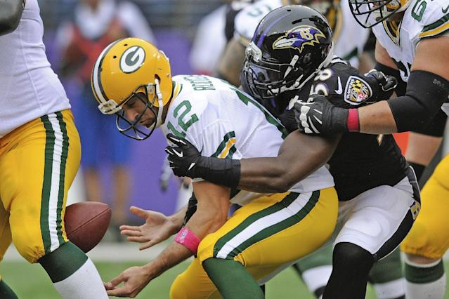 Green Bay Packers quarterback Aaron Rodgers (12) loses control of the ball on a sack by Baltimore Ravens outside linebacker Elvis Dumervil during the first half of an NFL football game in Baltimore, Sunday, Oct. 13, 2013. (AP Photo/Nick Wass)