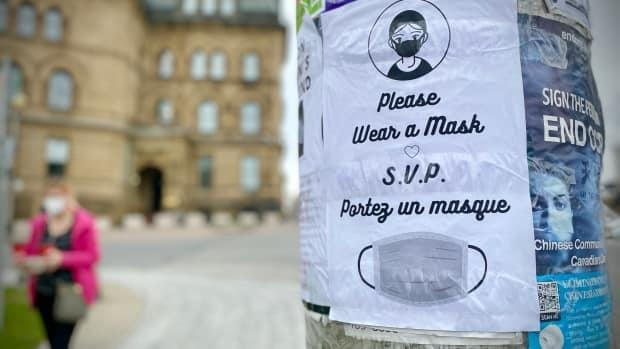 A poster pleads with people to wear a mask in downtown Ottawa on April 29, 2021.