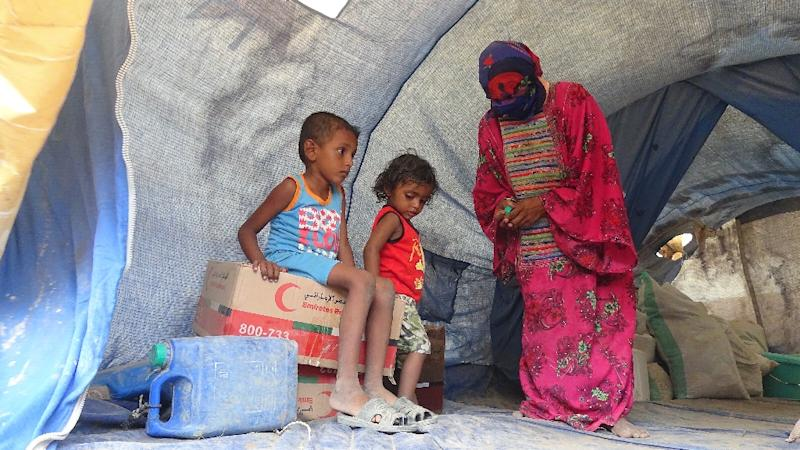 Imad (L) his sister Alia (C) and their mother rest in their tent at al-Waara camp in the Khokha district, some 30 kilometres (18 miles) from Hays, on October 1, 2018 after being forced from their home when their father was killed by a landmine (AFP Photo/NABIL HASSAN)