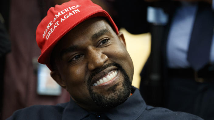 Rapper Kanye West smiles as he listens to a question from a reporter during a meeting in the Oval Office of the White House with President Donald Trump in 2018, in Washington. (Evan Vucci/AP)
