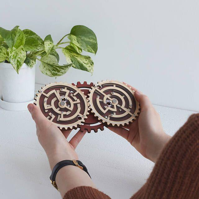 """<p><strong>Uncommon Goods</strong></p><p>uncommongoods.com</p><p><strong>$20.00</strong></p><p><a href=""""https://go.redirectingat.com?id=74968X1596630&url=https%3A%2F%2Fwww.uncommongoods.com%2Fproduct%2Fconstantin-brainteasers&sref=https%3A%2F%2Fwww.goodhousekeeping.com%2Fholidays%2Ffathers-day%2Fg21205637%2Ffathers-day-gifts-for-grandpa%2F"""" rel=""""nofollow noopener"""" target=""""_blank"""" data-ylk=""""slk:Shop Now"""" class=""""link rapid-noclick-resp"""">Shop Now</a></p><p><a href=""""https://www.goodhousekeeping.com/life/g22664296/best-jigsaw-puzzles/"""" rel=""""nofollow noopener"""" target=""""_blank"""" data-ylk=""""slk:Adult puzzles"""" class=""""link rapid-noclick-resp"""">Adult puzzles</a> and <a href=""""https://www.goodhousekeeping.com/life/entertainment/g3751/viral-brain-teasers/"""" rel=""""nofollow noopener"""" target=""""_blank"""" data-ylk=""""slk:brain-teasing games"""" class=""""link rapid-noclick-resp"""">brain-teasing games</a> are great for exercising his mind while keeping him entertained for hours. In this game, Grandpa will have to move the ball out of each maze until it escapes — a more complex version of Pinball!</p>"""