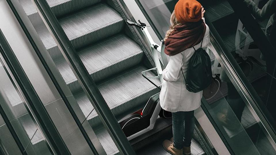 The foldable Clever Commute e-scooter can be easily carried about the city. - Credit: BMW