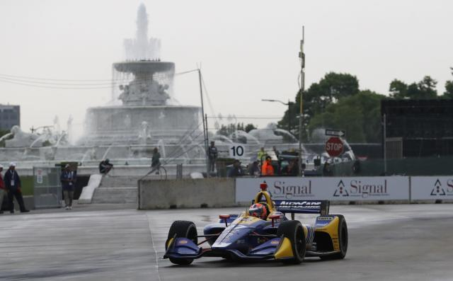Alexander Rossi takes the 10th turn during the first race of the IndyCar Detroit Grand Prix auto racing doubleheader, Saturday, June 1, 2019, in Detroit. (AP Photo/Carlos Osorio)