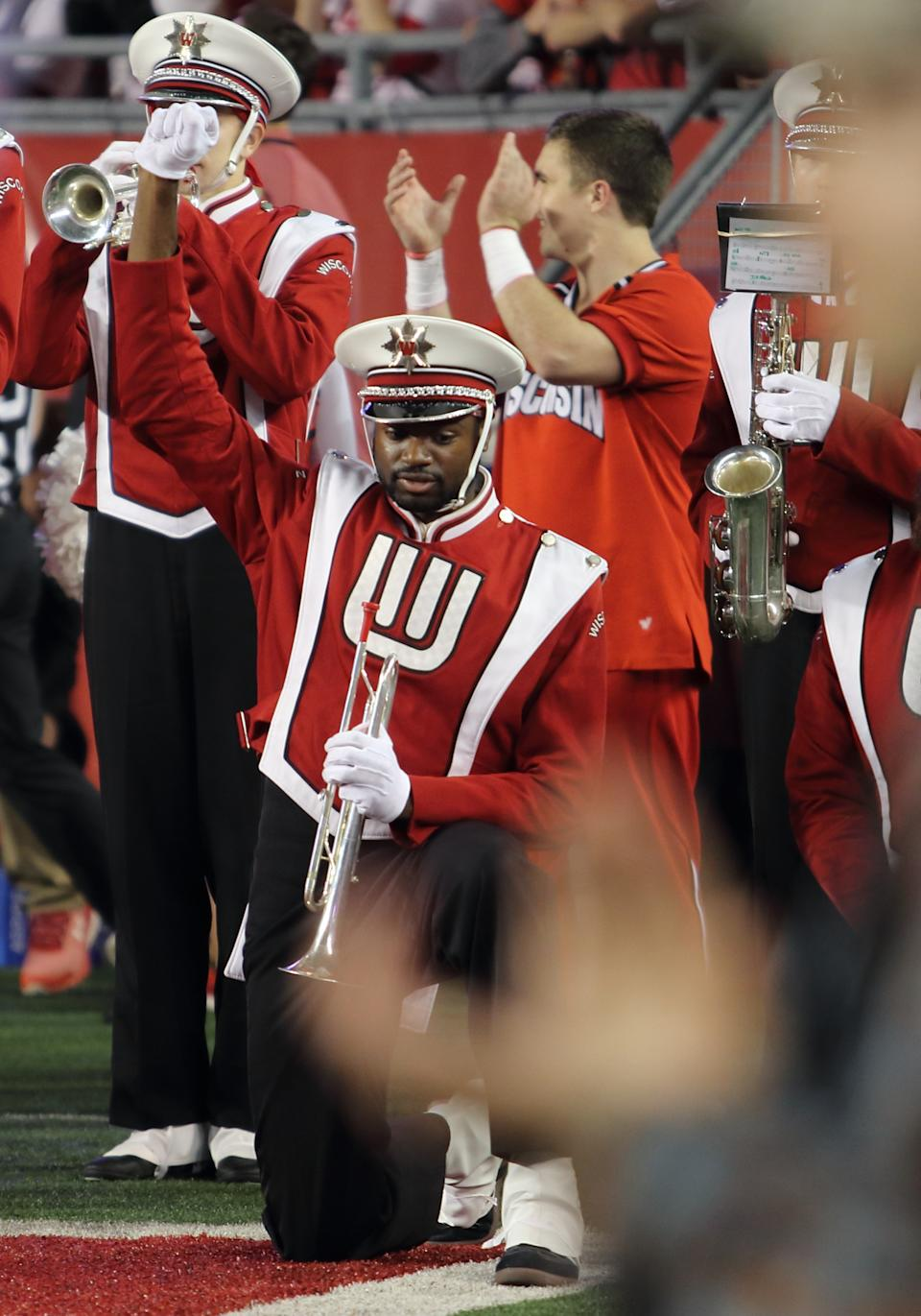 A Wisconsin Badger band member kneels during the playing of the National Anthem. Ohio State beat Wisconsin by a final score of 30-23 in overtime at Camp Randall Stadium in Madison, WI. on Oct. 15, 2016. (Photo by Patrick S Blood/Icon Sportswire via Getty Images)