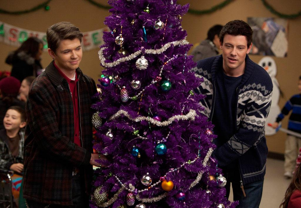 "Rory (Damian McGinty) and Finn (Cory Monteith) bring a Christmas tree to a homeless shelter in the ""Extraordinary Merry Christmas"" episode of ""Glee."""