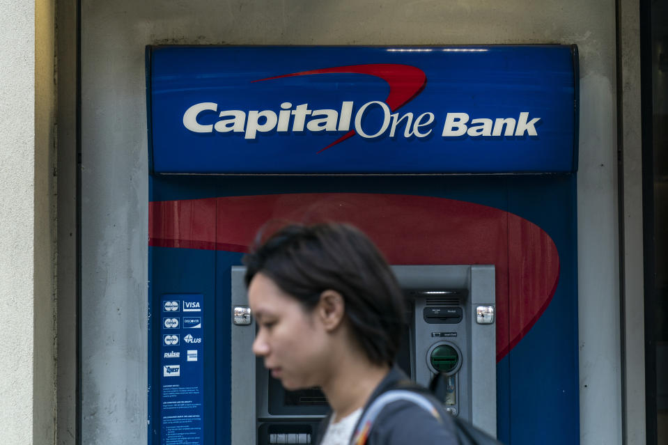 NEW YORK, NY - JULY 30: A woman walks past a Capital One ATM in the Lower East Side of Manhattan on July 30, 2019 in New York City. In one of the largest-ever thefts of bank data, a software engineer in Seattle was arrested for hacking into a Capitol One server and obtaining the personal data of over 100 million people. The data includes social security numbers, bank account numbers, names, addresses, credit scores, credit limits, balances, and other information. (Photo by Drew Angerer/Getty Images)
