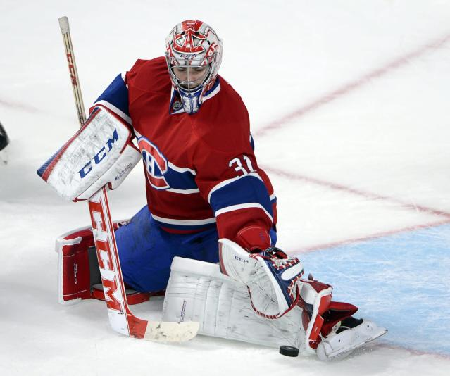 Montreal Canadiens goaltender Carey Price makes a save during the third period of an NHL preseason hockey game, Thursday, Sept. 26, 2013 in Montreal. (AP Photo/The Canadian Press, Ryan Remiorz)