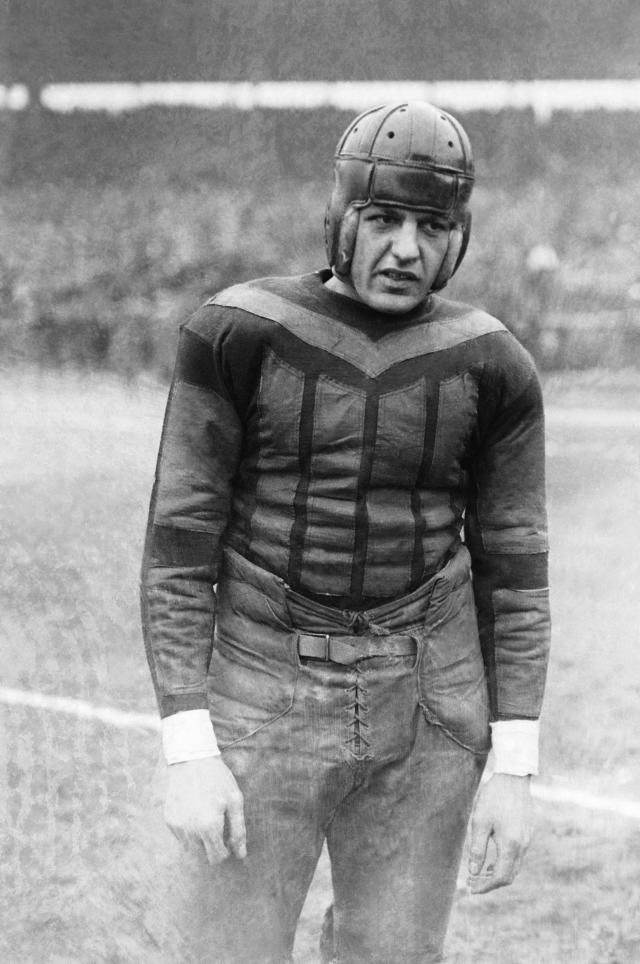 "This undated file photo shows football player Harold ""Red"" Grange. From the crude, oblong leather helmets to the sparsely padded brown and blue vertical-striped uniforms of the Chicago Bears, it's easy to see how equipment has drastically evolved in the NFL since the days of The Galloping Ghost in the 1920s and '30s. From their heads to their toes, the players' looks through the decades have changed so much, it's tough to believe it's all the same sport. (AP Photo)"
