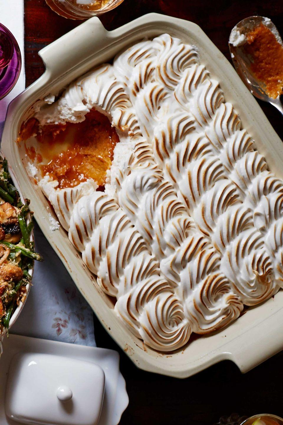 "<p>A sweet update to a holiday must-have. You can roast the sweet potatoes up to 2 days ahead, and a jar of marshmallow creme makes it sneakily easy.</p><p><strong><a href=""https://www.countryliving.com/food-drinks/recipes/a5865/maple-meringue-potato-casserole-recipe-clx1114/"" rel=""nofollow noopener"" target=""_blank"" data-ylk=""slk:Get the recipe"" class=""link rapid-noclick-resp"">Get the recipe</a>.</strong></p><p><strong><a class=""link rapid-noclick-resp"" href=""https://www.amazon.com/Puffed-Marshmallow-Creme-Ounce-Jars/dp/B002VC23JQ/?tag=syn-yahoo-20&ascsubtag=%5Bartid%7C10050.g.34554232%5Bsrc%7Cyahoo-us"" rel=""nofollow noopener"" target=""_blank"" data-ylk=""slk:SHOP MARSHMALLOW CREME"">SHOP MARSHMALLOW CREME</a><br></strong></p>"