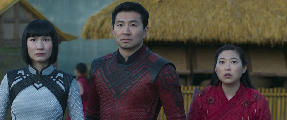 """This image released by Marvel Studios shows Meng'er Zhang, Simu Liu and Awkwafina in a scene from """"Shang-Chi and the Legend of the Ten Rings."""" (Marvel Studios via AP)"""