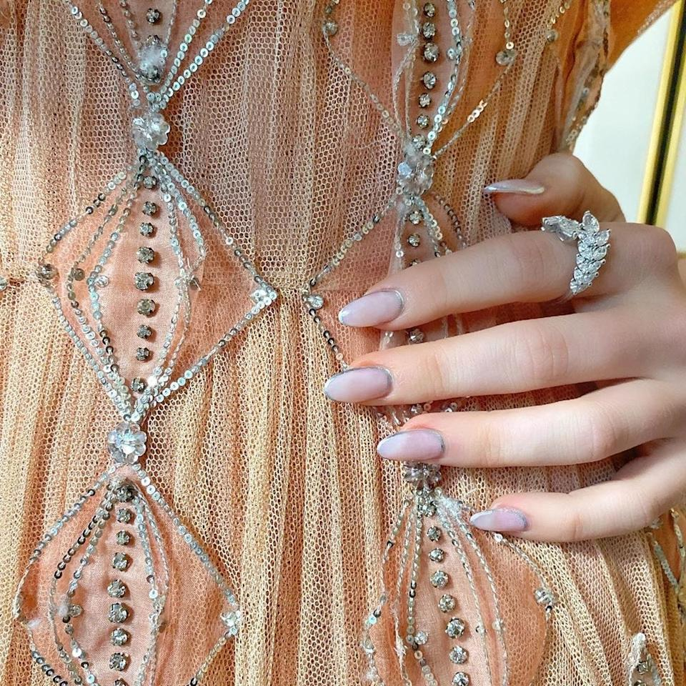 """Zoey Deutch wore a <a href=""""https://www.instagram.com/p/B3d03AkAX21/"""">delicate chrome manicure</a> by Betina Goldstein that paired nicely with her Dior gown. Courtesy of Instagram."""