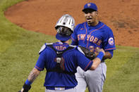 New York Mets catcher Toms Nido (3) and relief pitcher Edwin Diaz celebrate after defeating the Miami Marlins 8-3 during a baseball game, Tuesday, Aug. 18, 2020, in Miami. (AP Photo/Lynne Sladky)