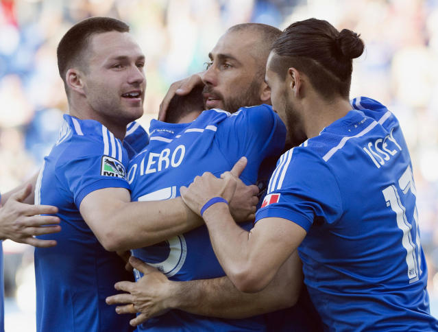 Montreal Impact's Andres Romero, center, celebrates with teammates Jack McInerney, left, Marco Di Vaio, second right, and Issey Nakajima-Farran after scoring against New England Revolution during first half MLS soccer action in Montreal, Saturday, May 31, 2014. (AP Photo/The Canadian Press, Graham Hughes)