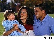 Happy couple with young child, hopefully not victims of adoption scam