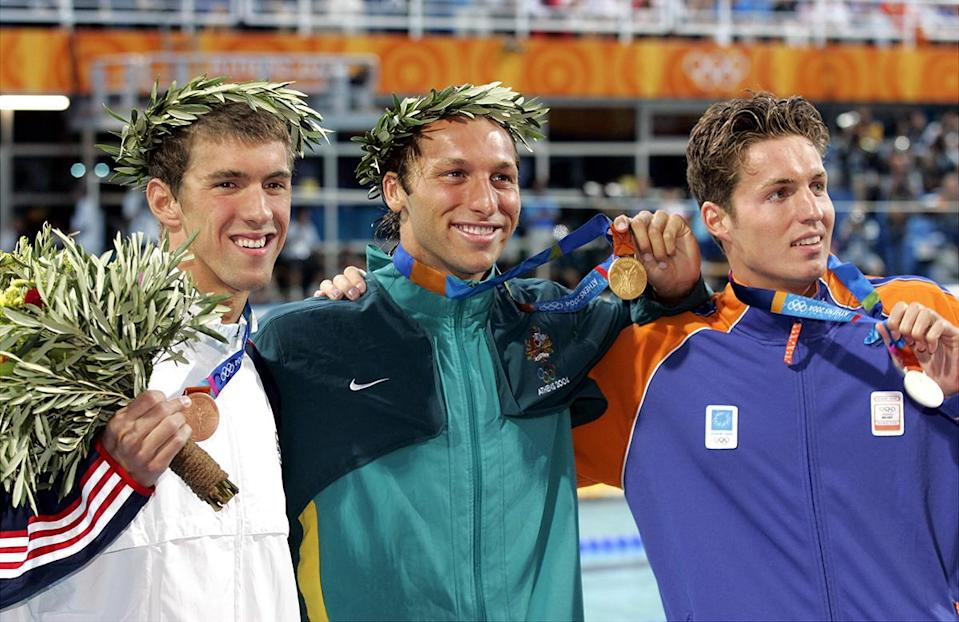 <p>Ian Thorpe (center), the 200-meter freestyle gold medal winner, is flanked by bronze medalist Michael Phelps and silver medalist Pieter van den Hoogenband (right) at the 2004 Summer Olympic Games in Athens. (Corey Sipkin/NY Daily News Archive via Getty Images)</p>
