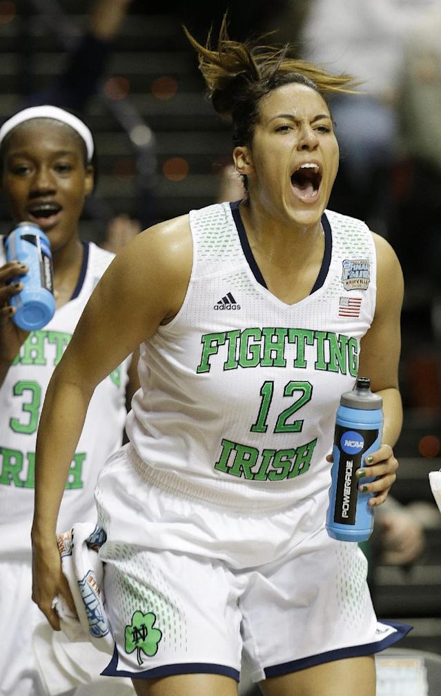 Notre Dame forward Taya Reimer (12) celebrates during the second half of the semifinal game against Maryland in the Final Four of the NCAA women's college basketball tournament, Sunday, April 6, 2014, in Nashville, Tenn. Notre Dame won 87-61. (AP Photo/Mark Humphrey)
