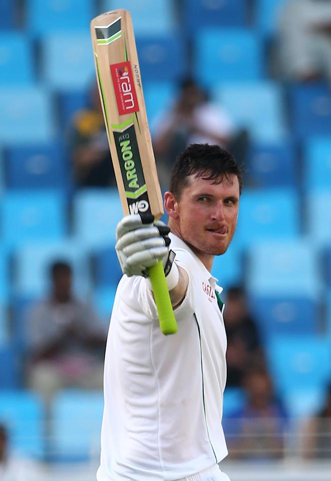 South African captain Graeme Smith (L) celebrates a double century during the second day of the second Test Match between Pakistan and South Africa at the Dubai International Cricket Stadium October 24, 2013. AFP PHOTO/ MARWAN NAAMANI        (Photo credit should read MARWAN NAAMANI/AFP/Getty Images)