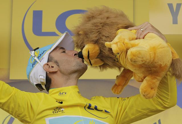 Italy's Vincenzo Nibali, wearing the overall leader's yellow jersey, celebrates on the podium of the second stage of the Tour de France cycling race over 201 kilometers (124.9 miles) with start in York and finish in Sheffield, England, Sunday, July 6, 2014. (AP Photo/Laurent Cipriani)