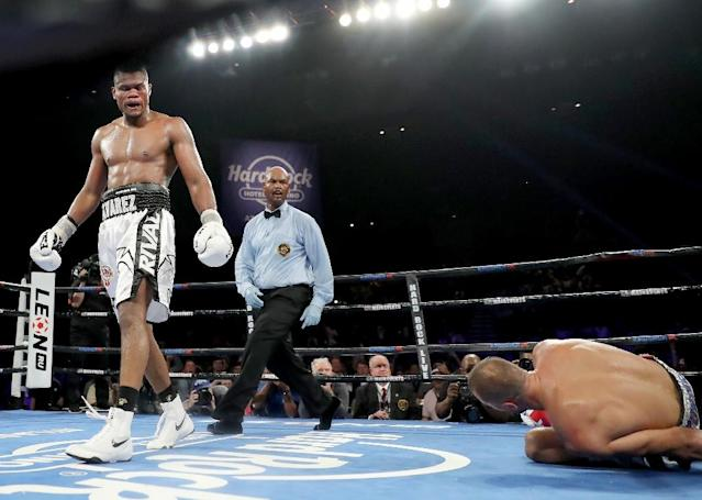 Eleider Alvarez walks to his corner after he knocked down Sergey Kovalev for the first time in the seventh round during their WBO/IBA Light Heavyweight Title bout (AFP Photo/ELSA)
