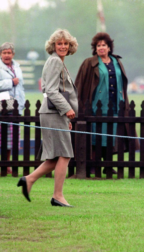 <p>Camilla sported a '90s-appropriate skirt suit with broad shoulder pads in gray to the Queen's Cup polo match at Windsor in 1992. </p>