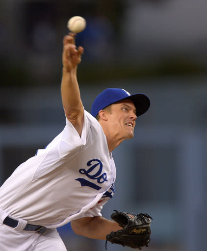Los Angeles Dodgers starting pitcher Zack Greinke throws to the plate during the first inning of their baseball game against the Chicago Cubs, Monday, Aug. 26, 2013, in Los Angeles. (AP Photo/Mark J. Terrill)