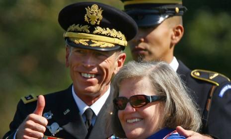 Happier times: David Petraeus, with his wife Holly, gives a thumbs up during an Armed Forces Farewell Tribute and Retirement Ceremony on Aug. 31, 2011, in Ft. Myer, Virginia.