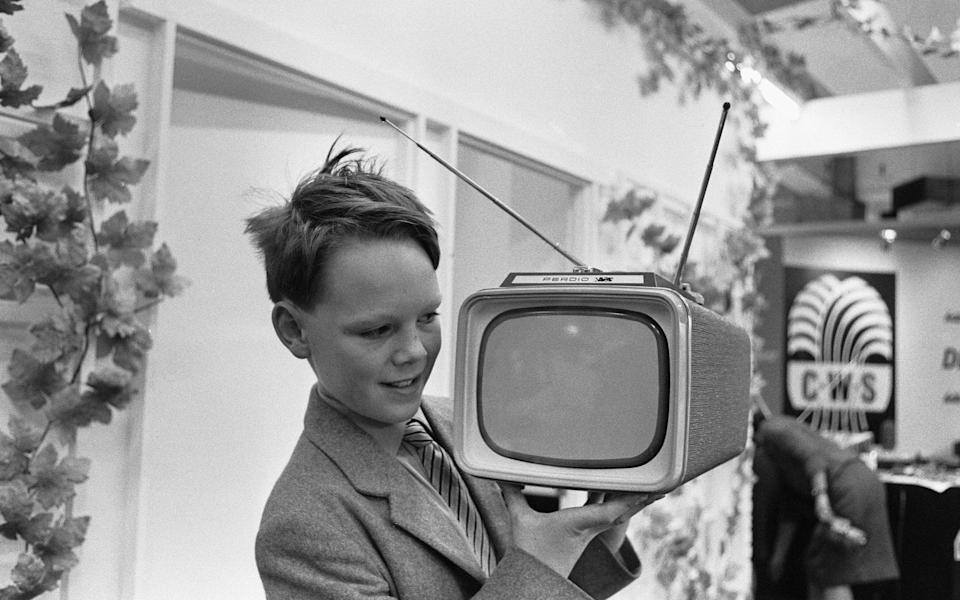 A young boy demonstrating the new Perdio Portorama portable television receiver at the National Radio Show, at Earls Court, London 22nd August 1961. (Photo by Ron Burton/Mirrorpix/Getty Images)  - Getty