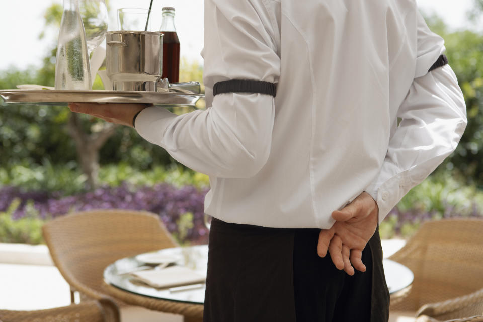 A waiter — like the one pictured here — received a crowdfunded tip.