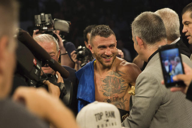 Vasiliy Lomachenko smiles after his victory against Jorge Linares, of Venezuela, during their WBA lightweight championship boxing match Saturday, May 12, 2018, in New York. (AP Photo)