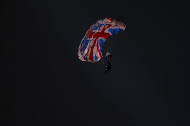 LONDON, ENGLAND - JULY 27: A performer in the role of Daniel Craig as James Bond parachutes out of a helicopter with a Union Jack parachute during the Opening Ceremony of the London 2012 Olympic Games at the Olympic Stadium on July 27, 2012 in London, England. (Photo by Ezra Shaw/Getty Images)