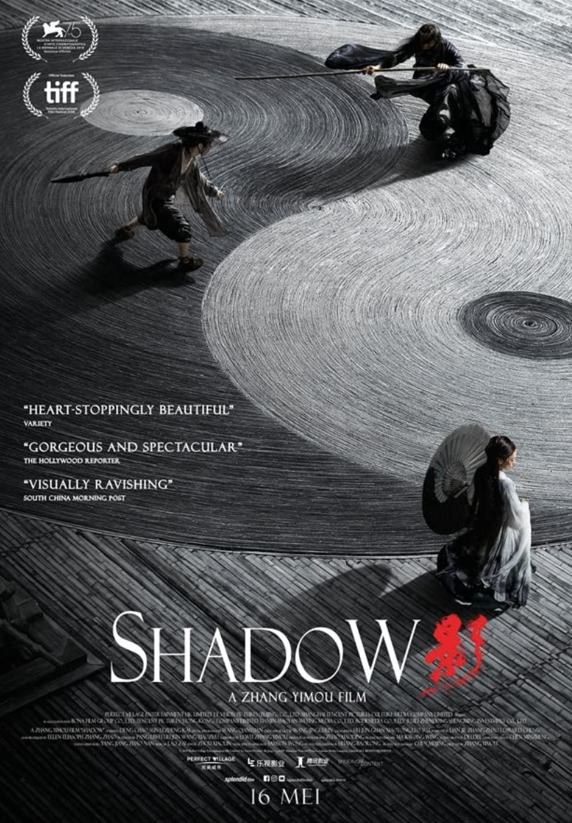 <p>No one does epic cinema like Zhang Yimou (<em>House of Flying Daggers</em>, <em>Hero</em>.) Which is maybe why the narrow locale of the film's first two acts somehow feels enormous. Set during China's Three Kingdom period, Shadow is epic poetry put to screen, and even though it is theatrical, it is never untrue. </p>