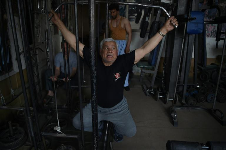 Afghan bodybuilding legend Aziz Arezo, 61, says he was inspired to take up the sport in his youth after seeing movies and posters featuring foreigners such as Arnold Schwarzenegger