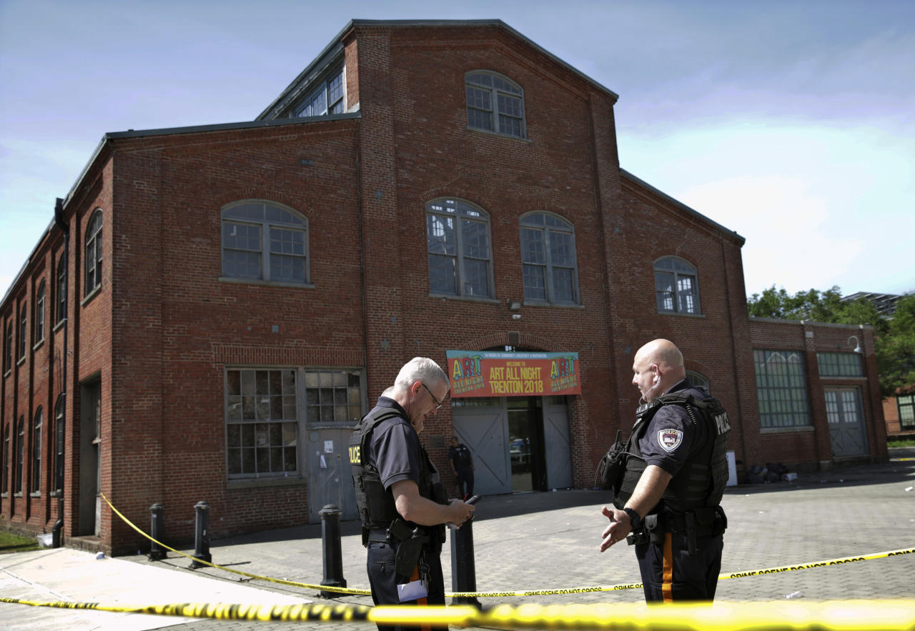 <p> Police stand guard outside the warehouse building where the Art All Night Trenton 2018 festival that was the scene of a shooting that resulted in numerous injuries and at least one death Sunday, June 17, 2018, in Trenton, N.J. (AP Photo/Mel Evans) </p>