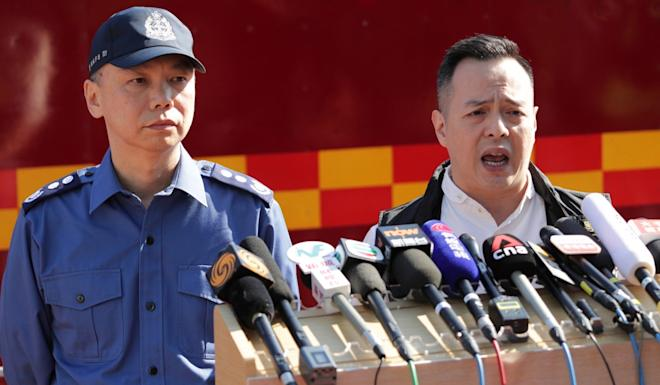 Assistant Commissioner of Police Chow Yat-ming (right), and Deputy Chief Fire Officer Wong Chun-yip give an update at Polytechnic University. Photo: Edmond So