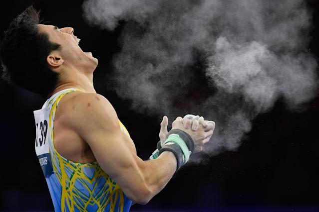 13 October 2019, Baden-Wuerttemberg, Stuttgart: Gymnastics: World Championships, apparatus finals, men: Arthur Mariano from Brazil reacts after his practice on high bar. Photo: Tom Weller/dpa (Photo by Tom Weller/picture alliance via Getty Images)