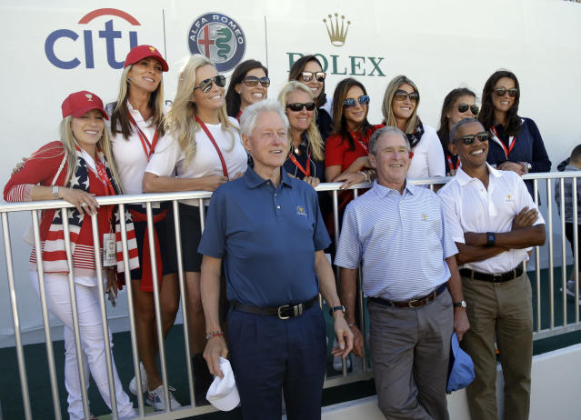 <p>Former Presidents, from left, Bill Clinton, George Bush and Barack Obama pose with wives of the U.S. team's players before the first round of the Presidents Cup at Liberty National Golf Club in Jersey City, N.J., Thursday, Sept. 28, 2017. (AP Photo/Julio Cortez) </p>