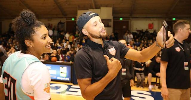 """Azzi Fudd poses for a photo with Golden State Warriors guard <a class=""""link rapid-noclick-resp"""" href=""""/nba/players/4612/"""" data-ylk=""""slk:Stephen Curry"""">Stephen Curry</a>. (Photo credit: Cassy Athena/Under Armour)"""