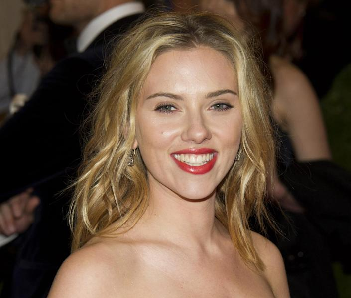 "FILE - This May 7, 2012 file photo shows actress Scarlett Johansson arriving at the Metropolitan Museum of Art Costume Institute gala benefit in New York. Producers on Thursday unveiled the Tony Award-winning Johansson for a revival of Tennessee Williams's ""Cat on a Hot Tin Roof."" It will be Johansson's first time back since winning a Tony in the Arthur Miller play ""A View from a Bridge"" opposite Liev Schreiber in 2010. (AP Photo/Charles Sykes, file)"